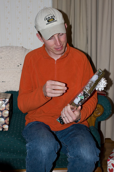 Chris looking for the weak point in the wrapping