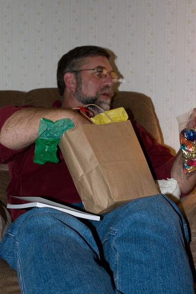 Gene opening a gift