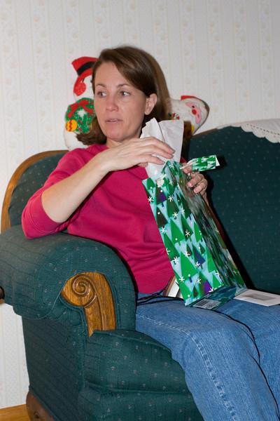 Teresa opening a gift