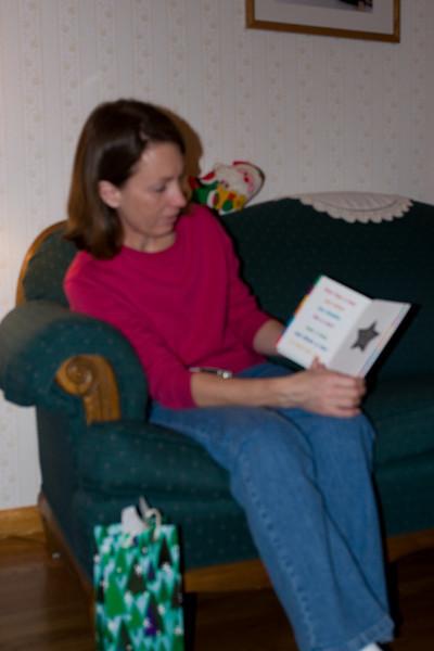 Teresa reading a card