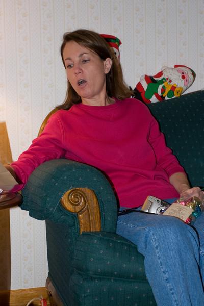 Teresa looking at a gift