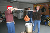 Christmas Day an Ken's & Jeannette's: Ken and Brian dunk the turkey