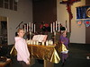 Brianna and Anna, two of the people who helped decorate the church for Christmas Eve.  (Note the graceful adornment of the cross... c/o Ryan.  Who knew???)