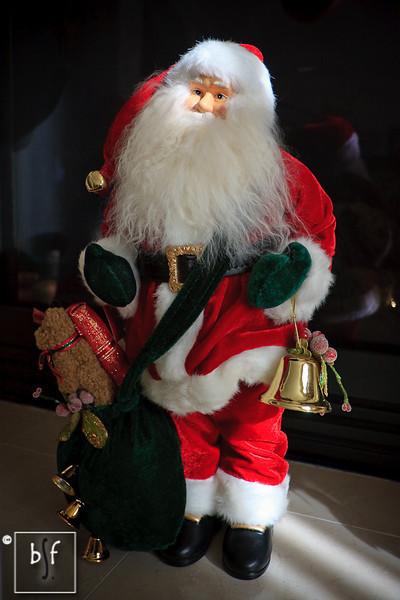A little bit of sunlight from the living room window illuminated Santa's face.