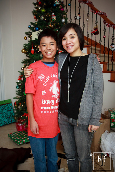 """Andrew and Ly. Andrew and Ly. Ly got Andrew a funny Vietnamese spicy chili sauce t-shirt for Christmas. """"20% Less MSG. Shake first."""" :-)"""