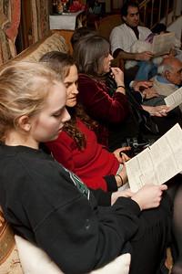 Claudia, Michelle, Mom and Richard sing carols.