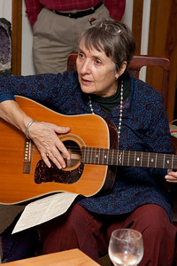 Caroling with Rosewitha playing the guitar.