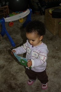 Reading the Christmas card from Bibi and Babu