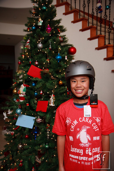 Andrew is wearing his new snowboard helmet and spicy chili sauce t-shirt.