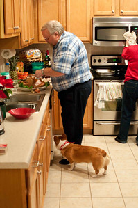 Don carving the turkey with and very patient and optimistic Tessa waiting...
