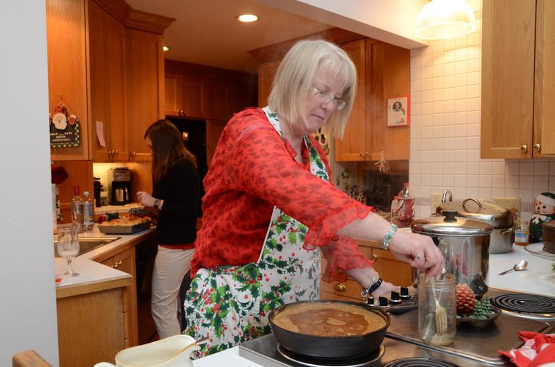 Judy making gravy.
