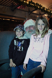 Reece and Reagan with Santa on Tennessee Valley Railroad Dec. 2010.  Extremely creative photography...no flash and iso was cranked up to 6400.  The light is from my cell then image captured with my dslr.
