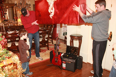 ...and Reece gets a new guitar which he plays quite well.  He has also been studying guitar for a year and a half and also doing well.  The elves are Reece's Dad, Jason, and uncle David, our two sons.