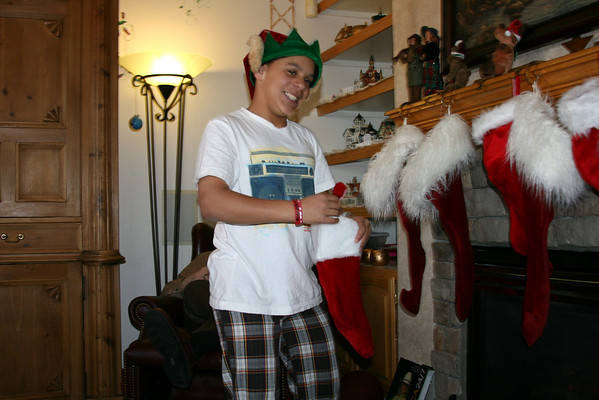 Helper elf hands out the stockings