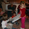 Violet helps pass out the presents.