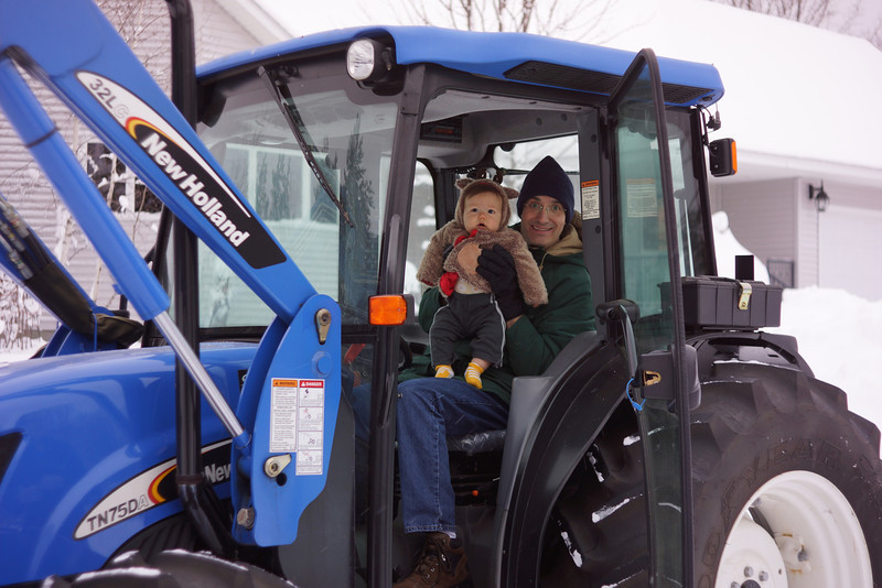 Hal and Grandpa shoveling snow