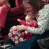 Mommy helping baby Eva unwrap her little presents!