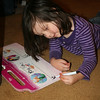 Gracie is practicing letter writing with her new book.