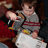 James ripping open a present.