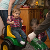 Zane getting on Jack's tractor