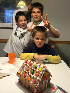 The boys made a gingerbread house and ate most of the candy.