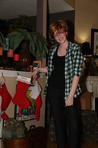 Sydney hangs her stocking