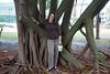 Debbie by a rubber tree.
