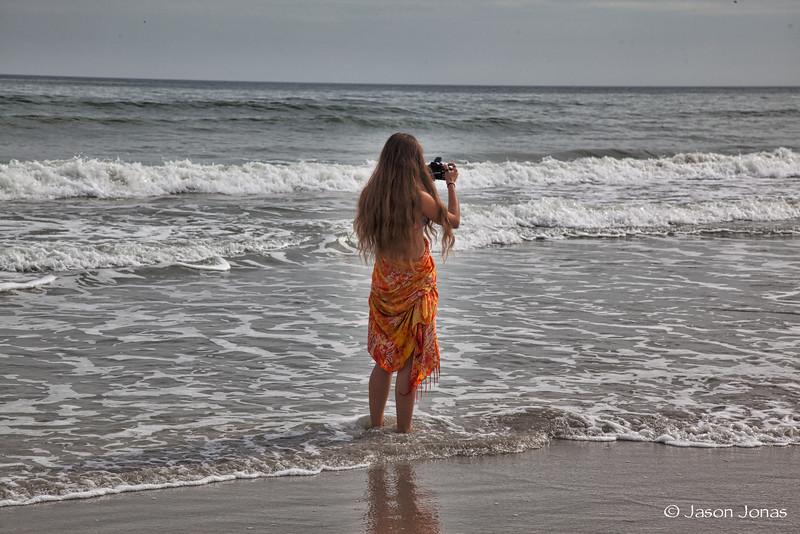 Someone else walking the beach taking photos.