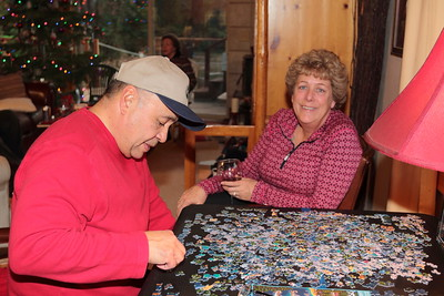 Dave takes a crack at the puzzle while Lydia looks on