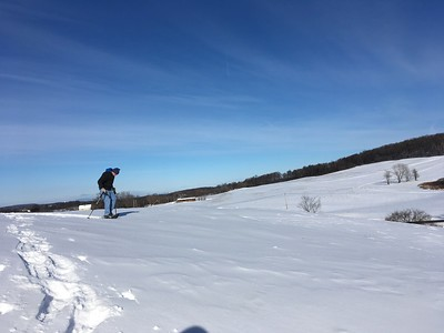 Joe packing down the toboggan trail with his snowshoes