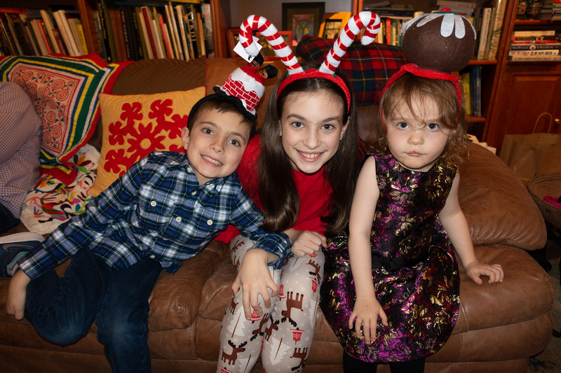 Will. Maddy and Fiona in Kevin's holiday headgear