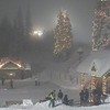 What a wonderful atmosphere with a warming fire in the foreground, Santa's workshop past the rink and a ski-lift showing over the trees....