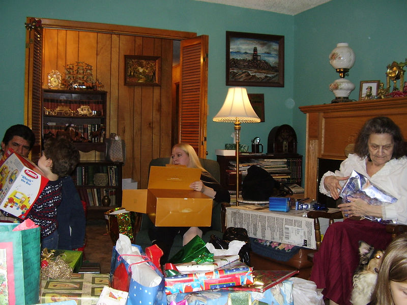 Opening gifts. Left to right: Tony, Carlos, Angela, Louise.