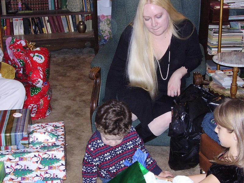 Angela, her son Carlos, and Kira.