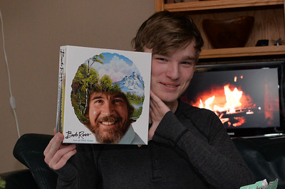 He's a huge Bob Ross fan.  This is the (utterly dorky) Bob Ross board game.