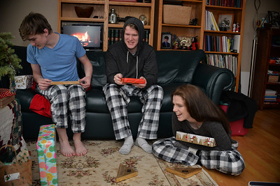 Everyone has a gift.  But they take turns opening.  Scott and Kemma have opened their Purdy's hedgehogs, and Nate's just unwrapping his  Purdy's peppermint bark.