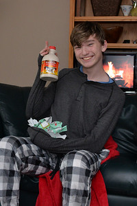 Nate is delighted by the maple syrup from Nonie and Poppa.