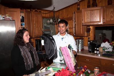 Christina and Porakan exchanging gifts