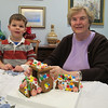Carter and grandma show off the finished train.