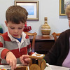 This is a short video of Crter and grandma decorating the gingerbread train.  If you are in Smugmug style mode, click the arrow to watch the video.