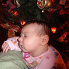 Emma sleeping on Auntie Robin Christmas Eve