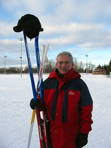 Grandad finishes cross country skiing for the day