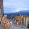 Back porch with rockers; Smoky Mts. at dusk
