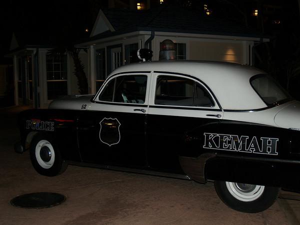 Night scene at Kemah; classic police car