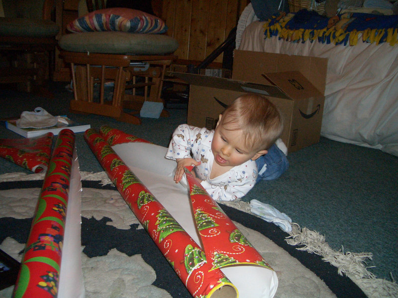Cody helping mommy wrap presents. 12/20