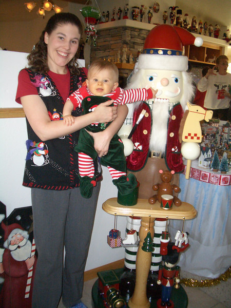 Katie & Cody by life size nutcracker at grandma Barb's Christmas party. 12/16