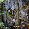 Follow the rock wall to a triangular entrance that will lead you to a secret passageway.