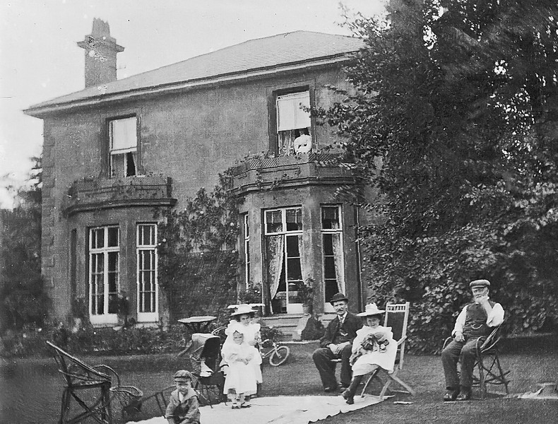 Clarke family sitting on the lawn at the Grove