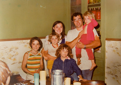 Here's a shot from the early days of the farm. This may be the summer of 1976, which would make me 8 years old. Removing the olive green walls was one of the first things my parents did, but obviously not before we were already canning vegetables and milking cows (and serving the milk in tins). My parents still use this table and chairs.