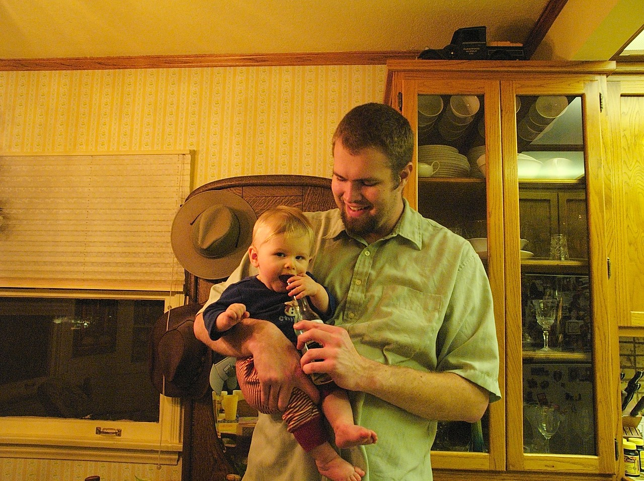 Cody helps daddy hold the bottle.   2/25
